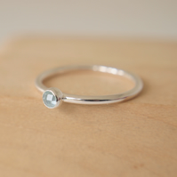 Blue Topaz and Silver Ring. March Birthstone