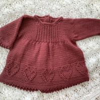 Hand knitted baby dress, newborn size
