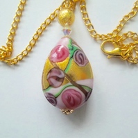 Gold and pink Murano glass pear drop pendant with Swarovski crystal.