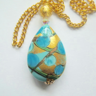 Blue and gold Murano glass pear drop pendant with Swarovski and gold chain.