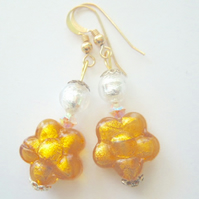 Gold and silver Murano glass flower earrings with gold filled ear wires.