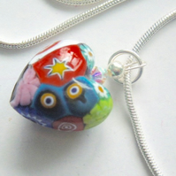Murano glass millefiori handmade heart pendant with Swarovski crystal.