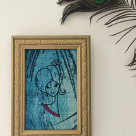 Hand Embroidered Girl on Vintage Blue Barkcloth Fabric in a Vintage Frame.