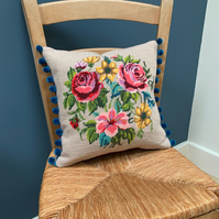 Wool tapestry cushion with pompoms