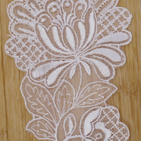 Large white embroidered sew-on embellishment