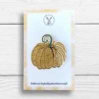 A fairytale glitter pumpkin pin badge