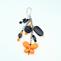 Handbag charm - orange and black.
