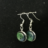 Aurora button dangly and stud earrings.