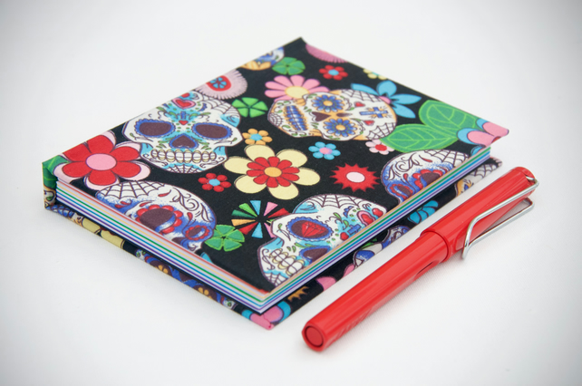 A6 hardback notebook with full cloth bright skull cover