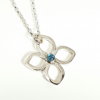 Silver and Blue Topaz Flower Pendant Necklace