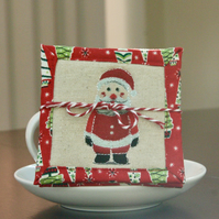 Set of Four Quilted Christmas Coasters with Santa, Trees and Snowflakes