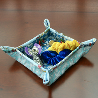 Quilted Fabric storage box with seashells on light and dark blue fabric