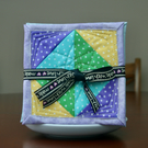 Set of four Fabric Coasters with Green, Yellow, Blue and Purple stars fabric.