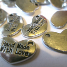 "10 x Tibetan Silver ""Hand Made with Love"" charms"