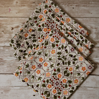 A set of 3 medium handkerchiefs in floral print and white. 100% cotton
