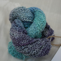 "40% silk, 60% wool 50g hand-dyed yarn ""ocean view"" in blue, purple and turquiose"