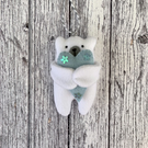 Hanging polar bear with heart decoration