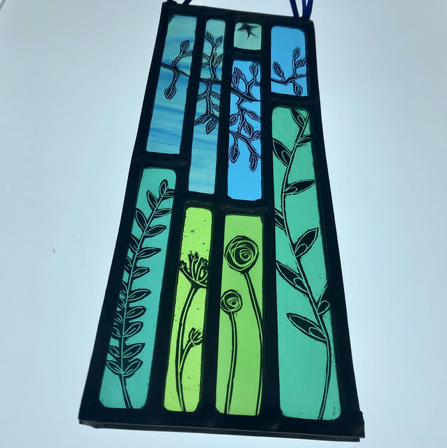 Stained glass panel inspired by the countryside, featuring wildflowers and trees
