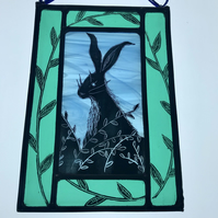 Stained glass panel of a hare