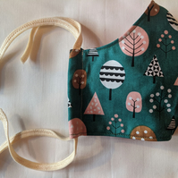 Cotton face mask with autumnal pastel tree pattern