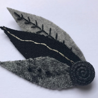 Black and Grey HarrisTweed Corsage. Hand embroidered in silver and black thread.