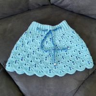Aqua mini skirt with royal blue sequins and 3 shades of blue chord. Size XS.