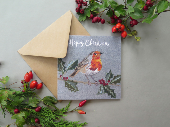 Robin on a holly branch Christmas card