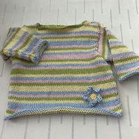 Striped jumper with flower decoration