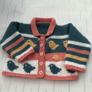 Hand knitted cardigan with chick design