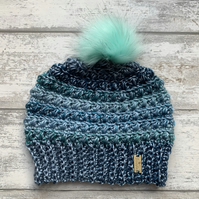 Handmade green and blue crochet beanie hat with colourful green faux fur pompom