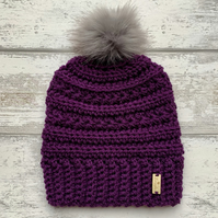 Handmade aubergine purple crochet beanie hat with faux fur pompom