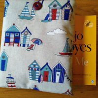Book sleeve with beach huts and boats