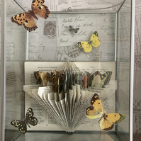 Observer book of butterflies sculpture