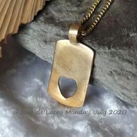 Bronze Pendant with Heart Apperture