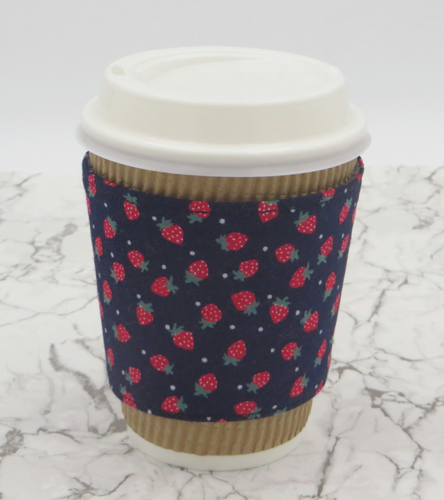 Fabric Cup Cosy in strawberry print, fully reversible and reusable cup holder