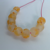 10 African round beads of recycled glass 13 - 15 mm, clear mottled with orange