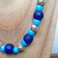 Blue and turquoise glass beaded necklace with chunky African brass beads