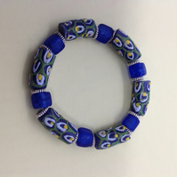 Stretch bracelet with multicoloured beads from Africa and blue beads from India