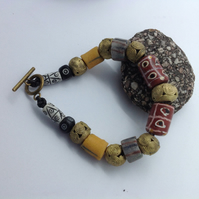 Man sized bracelet with antique tic tac toe trade beads, new African brass beads