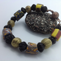 Man's bracelet with 5 rare old African trade beads, brass and ebony beads