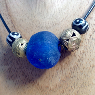 Blue surfer necklace with giant African glass, brass and Asian prayer beads