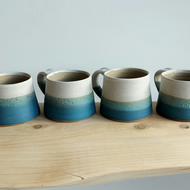 Beautiful  small handmade thrown stoneware pottery mug sea blue green