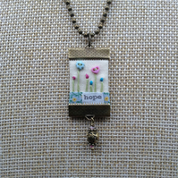 Hand sewn pendant necklace
