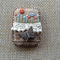 Hand sewn fabric felt and lace brooch