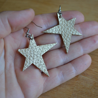 Gold leather star earrings