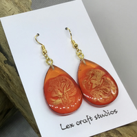 Amber and gold swirled drops