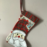 Christmas stocking with appliquéd Santa in tartan.
