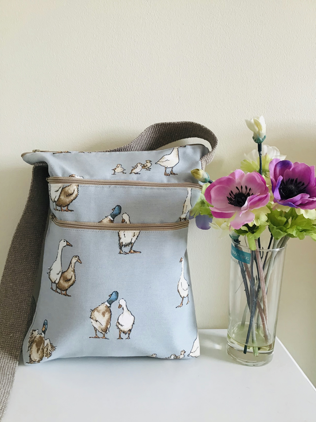 Crossbody or shoulder bag. Three zips. Ducks.