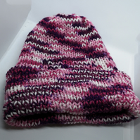 Handknitted pink, purple and white hat