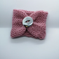 Handknitted pink glittery cup cosie